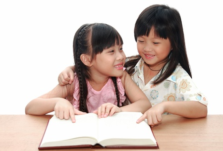 Intelligent little girl  reading a book Stock Photo - 11803373
