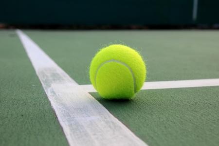 ball point: Tennis ball on tennis court Stock Photo