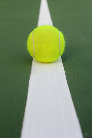 Tennis ball on tennis court photo
