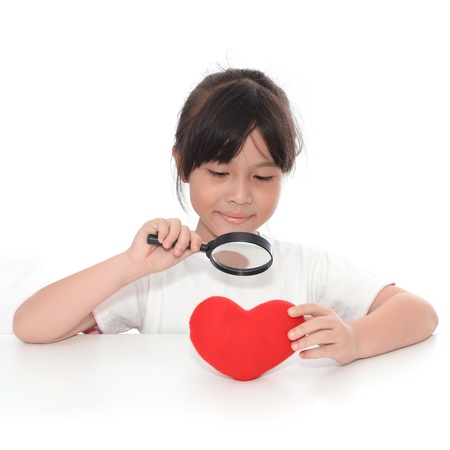 Asian cute girl giving symbol of red heart. photo