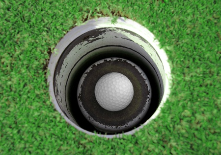 white hole: Golf ball in the hole Stock Photo