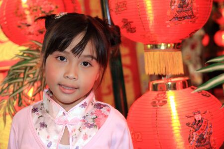 Adorable Chinese little girl in happy chinese new year photo