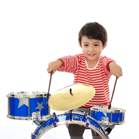 drummer: Asian young boy playing blue drum on white background