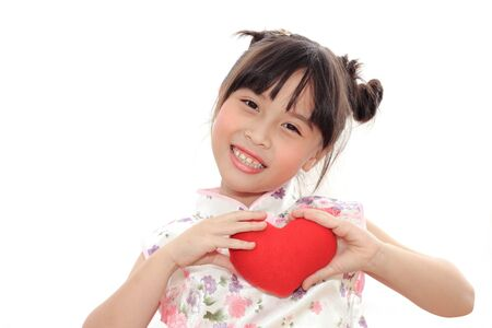 Adorable Chinese little girl holding red heart photo