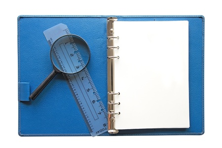 Blue Notebook hand glass and ruler isolated on white  background photo