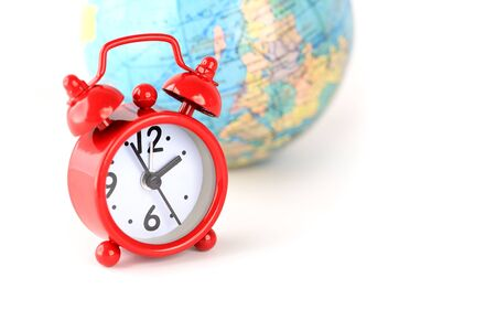 Red alarm clock and globe world time  photo