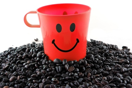 Red coffee cup with happy face on coffee feed photo