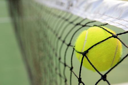 tennis net: Tennis ball in net