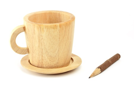 traditional wooden cup and pencil on isolated white background photo
