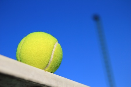 tennis net: Tennis ball and blue sky