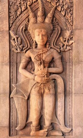 Apsara carvings on the wall of Angkor Wat Cambodia photo