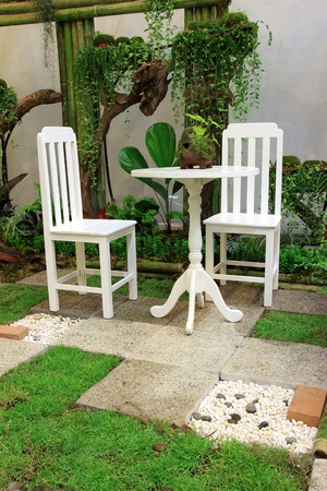 White Desk and chair in the garden photo