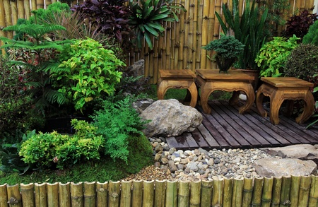 Wooden Desk and chair in the garden photo
