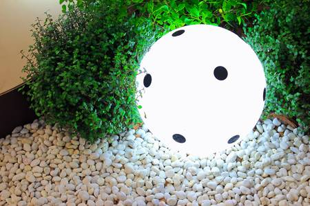 modern lamp on the floor with stone and plant photo