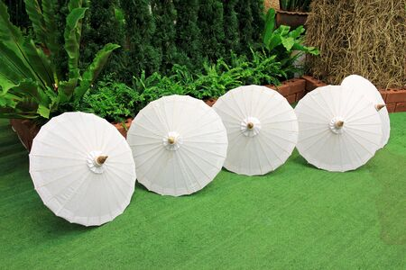 Fabric white umbrella on floor Stock Photo - 12233229