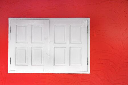 White wooden window on red wall photo