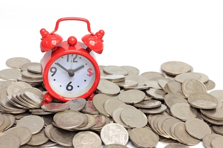 Alarm red clock with coins on white background, time is money concept  photo