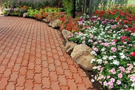 Beautiful walkway winding its way through a tranquil garden photo