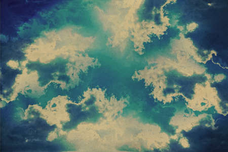 grunge heart clouds on the sky old paper background photo