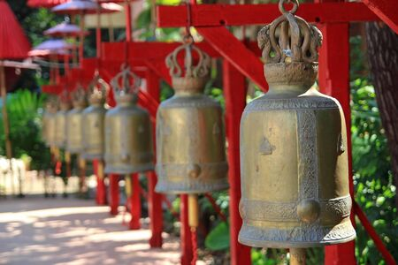 antique bells in a buddhist temple of Thailand photo