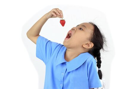 hand on mouth: Asian girl with strawberry