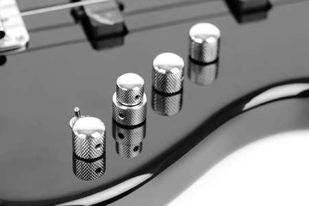 hardrock: Electric Bass Guitar isolated on white background Stock Photo