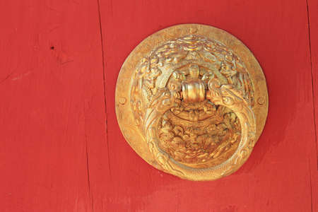 old golden door handle knocker  photo