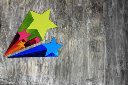 Colorful star on grunge wall photo