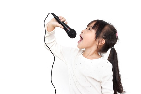 sing: pretty little girl with the microphone in her hand