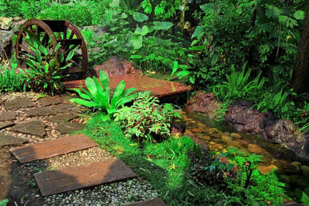 Wooden Water Wheel In The Garden Stock Photo, Picture And Royalty Free  Image. Image 12602505.