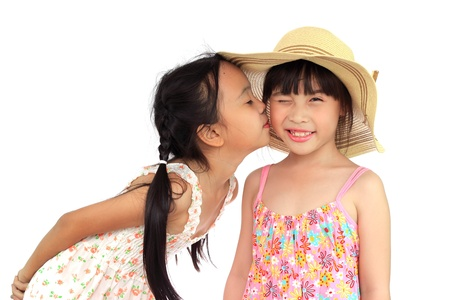 kissing lips: Two beautiful happy little asian girl