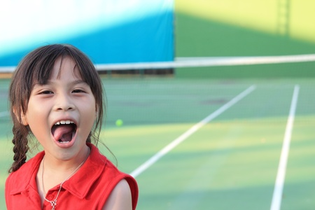 Portrait of sporty beautiful asian girl tennis player photo