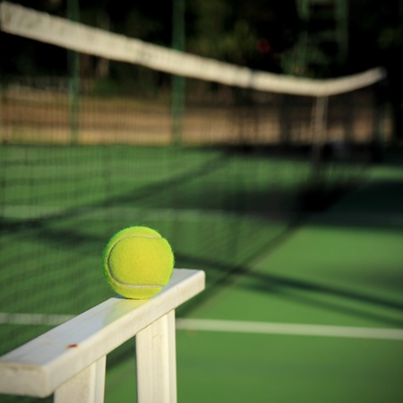 Tennis ball with net background photo