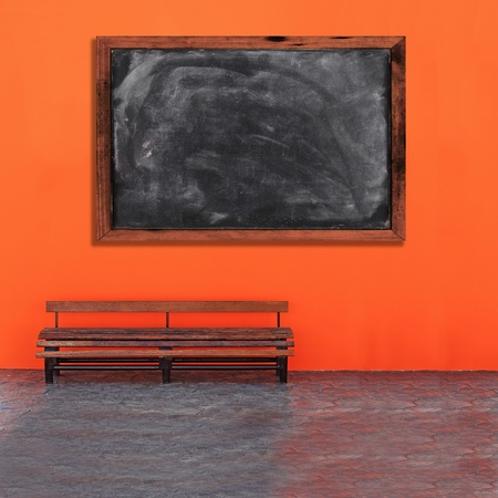 Vintage Bench Against blank grunge black board photo