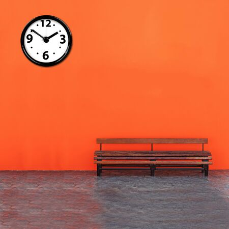 Vintage Bench Against with analog clock photo