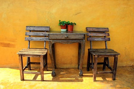 old vintage wooden chair and table photo