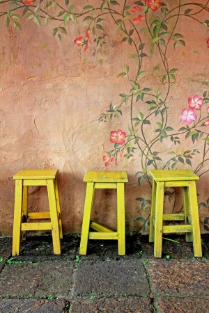 old vintage wooden chair and wall photo