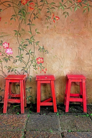 old vintage wooden chair and wall Stock Photo - 13407525