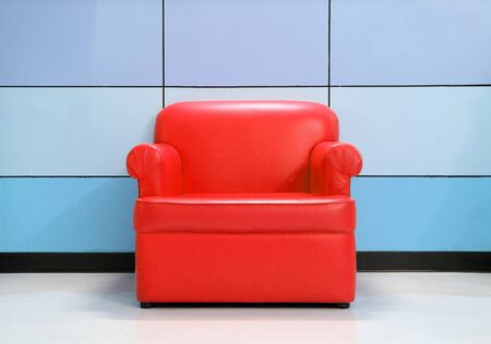 Red sofa and modern wall photo
