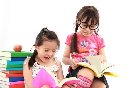 Two student little asian girl reading the book photo
