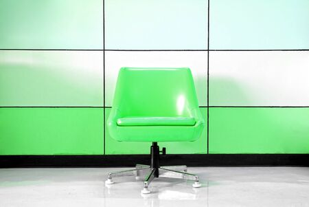Green chair and modern wall photo