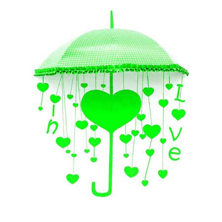 Green umbrella with heart and love photo