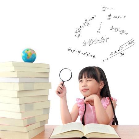 Genius little girl reading book isolated white background photo
