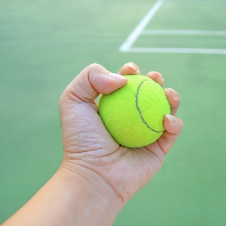 Tennis ball in hand photo