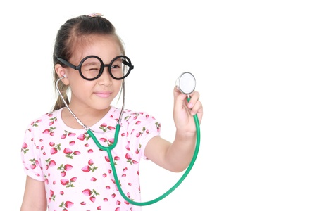asian little girl with stethoscope isolated white background photo