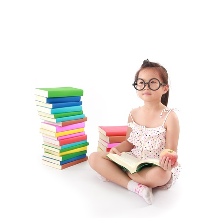 student little asian girl reading a book Stock Photo - 14000962