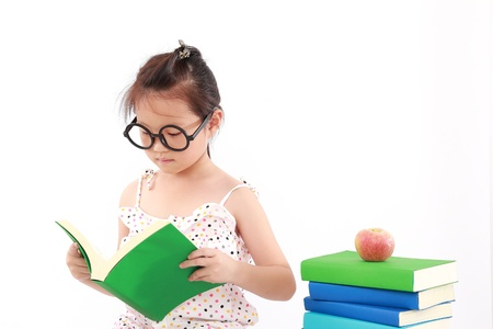 student little asian girl reading a book photo