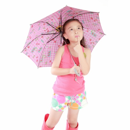 high key: smiling little girl with umbrella and boots on white background Stock Photo