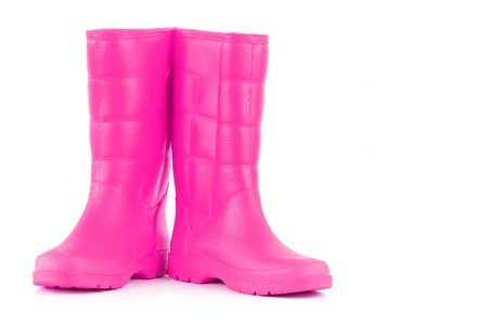 rain boots: A pair of pink rainboots isolated on a white background