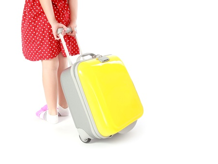 young traveler girl with suitcase isolated on a white background  photo